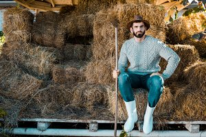 handsome male farmer in sweater and