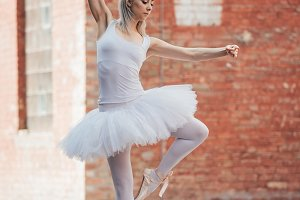 attractive young ballerina in white