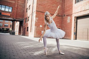 elegant young ballerina dancing in u