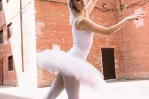 attractive ballerina in white tutu a