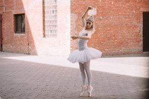 young ballerina in white tutu and po