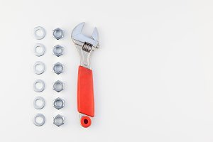 Flat lay of metal nuts and spanner