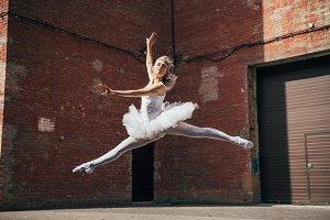 beautiful young ballerina jumping an