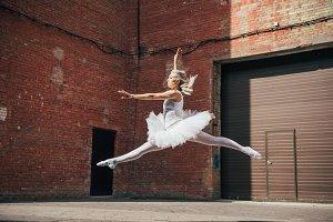 beautiful young ballerina jumping on