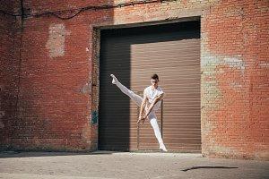 young ballet dancer dancing in jump