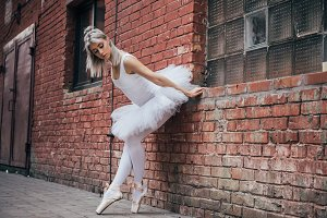 beautiful young ballerina leaning at