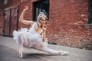 beautiful young ballerina looking at