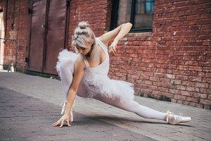 beautiful young ballerina dancing on