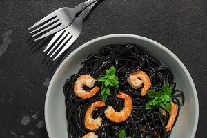 Black pasta with shrimps and basil