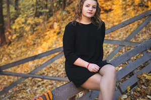 Adult girl in a beautiful autumn for