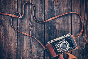 Old retro vintage camera on grunge