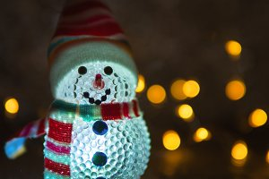 Christmas toy glowing snowman in the