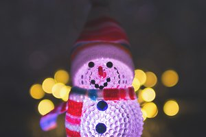 Small Christmas snowman glowing in t
