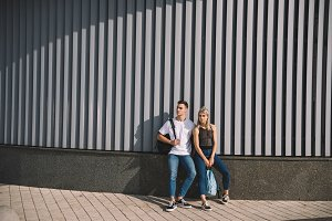 beautiful young couple with backpack