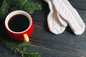 Coffee mug on a black wooden table w