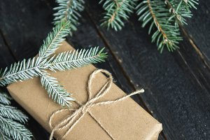 Gift for Christmas is on a dark wood