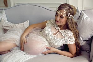pregnant girl in white see-through d