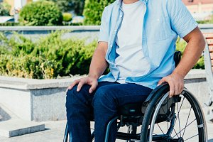 smiling handsome man in wheelchair l