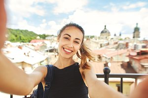 young woman tourist making selfie in
