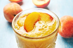 Peach smoothies in glass on the