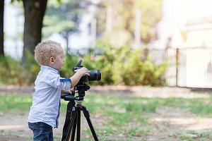 Little boy photographing on the came