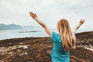 Woman raised hands enjoying view
