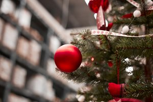 Red bauble hanging from a decorated