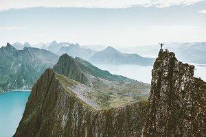 Man climbing in Norway traveler