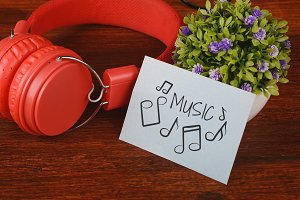 "Red headphones and paper with""music"""