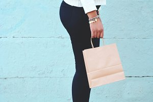 Female hands holding shopping bag ou