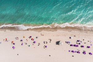 Ocean beach with people coastline
