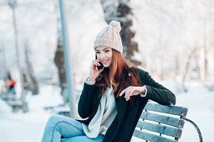 Young  woman smiling with smart phon