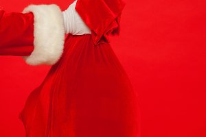 Christmas. Santa Claus hand holding