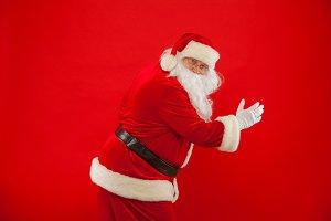 Running Santa Claus red background