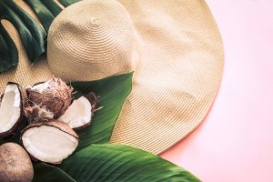 Summer still life with beach hat and