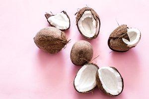 Coconut halves on pink background