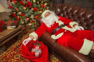 Santa Clause snoozing in a decorated