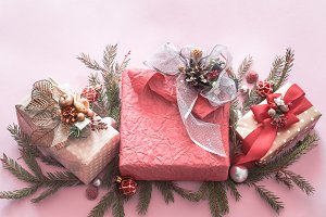 Beautiful gift holiday box on a pink