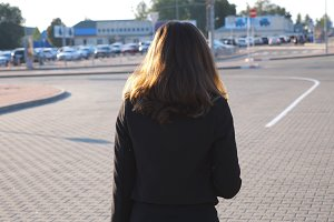 Young businesswoman walking at