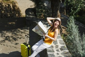 Excited laughing traveler tourist wo