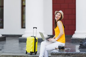 Laughing traveler tourist woman in c