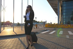 Young woman walking near airport