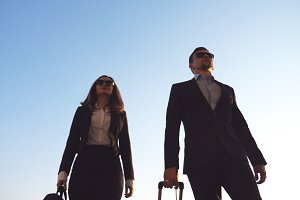 Business man and woman going to the