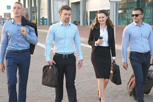 Group of young businessmen walking