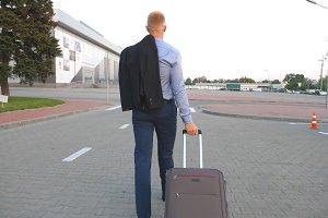 Young man walking on urban