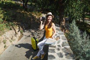 Happy traveler tourist woman in hat