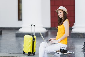 Smiling traveler tourist woman in ca