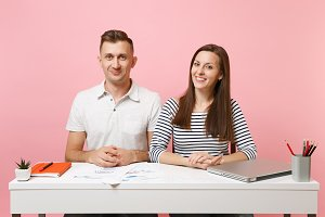 Two young smiling business woman man