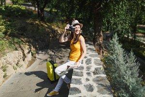 Smiling traveler tourist woman in ha