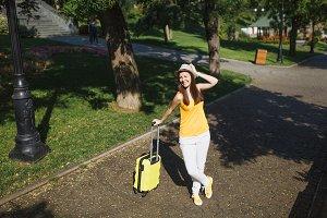 Joyful traveler tourist woman in yel